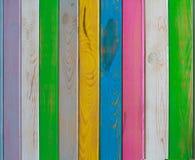 Multicolored gekleurde bars in een omheining Stock Foto