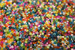 Multicolored glass seed beads background Stock Photo