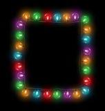 Multicolored glassy led Christmas lights garland like frame on b Royalty Free Stock Photos