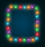 Multicolored glassy led Christmas lights garland like frame on b Stock Photo