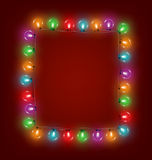 Multicolored glassy led Christmas lights garland like frame on r Royalty Free Stock Images