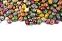 Multicolored glazed raisins on a white background royalty free stock photo
