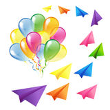 Multicolored glossy balloons and flying colorful paper planes is Royalty Free Stock Photo