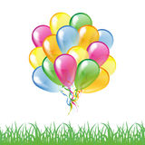 Multicolored glossy balloons with grass silhouette isolated on a Royalty Free Stock Photos