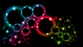 Abstract multicolored luminous rings on a black background. EPS 10. Multicolored glowing rings with sparkles on a black background Stock Photos