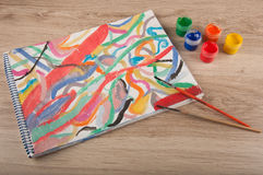 Multicolored gouache lines on paper, brushes and paintings Stock Photos