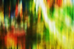 Multicolored green white orange blurred shades, shapes, geometries, abstract creative background. Multicolored vivid green white orange rainbow colors, blurred Royalty Free Stock Photography