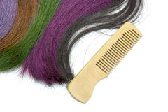Multicolored hair with wooden comb Royalty Free Stock Photography