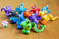 Multicolored handmade modelling clay dragons. Multicolored set of handmade toy dragons made with modelling clay Royalty Free Stock Photo