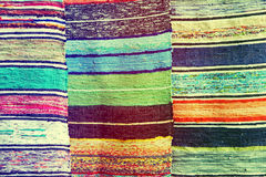 Multicolored handmade rugs as abstract background. Stock Image