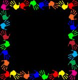 Multicolored handprints border isolated on black background. Bright rainbow frame with empty copy space for text or image and multicolored handprints border Stock Photo