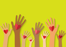 Multicolored hands holding red heart. Royalty Free Stock Image