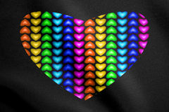 Multicolored heart from hearts on black fabric texture Stock Images