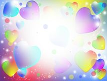 Colorful abstract hearts. Multicolored hearts flying in bright white light Royalty Free Stock Images
