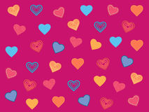 Multicolored hearts a magenta background Stock Images