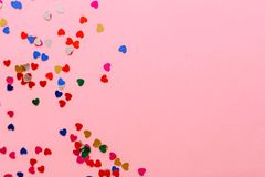 Multicolored hearts on a pink background. Place for inscription. stock photography