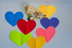 Multicolored hearts, sea pebbles and seashells. Royalty Free Stock Photography
