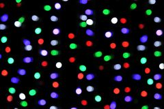 Multicolored highlights , Christmas garlands without focus royalty free stock photo