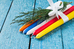 Multicolored holiday candles Royalty Free Stock Photos