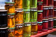 Multicolored honey in a jar on the counter. Royalty Free Stock Photography