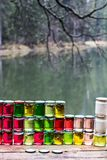 Multicolored honey in a jar on the counter. Royalty Free Stock Photos
