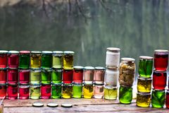 Multicolored honey in a jar on the counter. Stock Photos