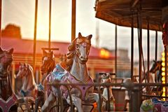 Multicolored horses on a carousel stock images
