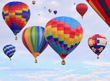 Multicolored hot-air balloons flying Royalty Free Stock Images