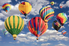 Multicolored hot air balloons flying Stock Photos