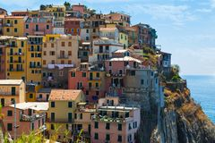 Multicolored  houses . Ancient city  Manarola , Italy. Royalty Free Stock Images