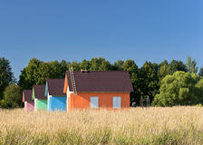 Multicolored houses in the field Royalty Free Stock Image