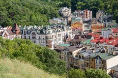 Multicolored houses surrounded by green trees. Kiev. Ukraine Stock Image