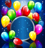 Multicolored inflatable balloons with circle frame on blue Stock Photography