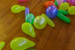 Multicolored inflatable balloons scattered on the floor royalty free stock images