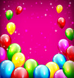 Multicolored inflatable celebration balloons like frame on viole Royalty Free Stock Photography