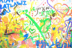 Multicolored inscriptions in Hebrew written in paints. On the wall Stock Photo