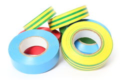 Multicolored insulating tapes on white background Stock Images