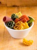 Multicolored italian pasta in bowl Stock Image