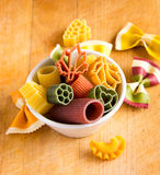 Multicolored italian pasta in bowl Royalty Free Stock Photo