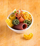 Multicolored italian pasta in bowl Royalty Free Stock Photos