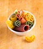 Multicolored italian pasta in bowl Royalty Free Stock Photos