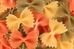 Multicolored italian pasta farfalle. Royalty Free Stock Images