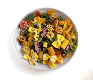 Multicolored italian pasta in plate,  Stock Images