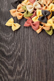 Multicolored italian pasta on wooden background Royalty Free Stock Photography