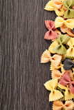 Multicolored italian pasta on wooden background Stock Photography