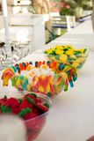 Multicolored jelly candies on a bar counter in vases royalty free stock photo