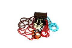 Multicolored jewelery. On a white background brown box near where colorful beads from costume jewelery Stock Photography