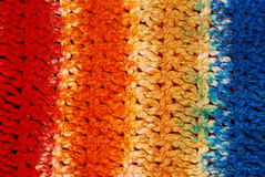 Multicolored knitted wool. Bright multicolored knitted wool background royalty free stock images