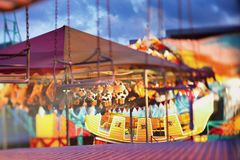 Multi-colored fair in the evening Royalty Free Stock Photos