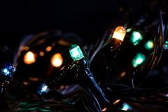 Multicolored lights of a New Years garland royalty free stock photo